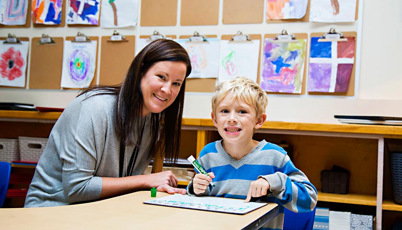 Exeter619-teacher-hleping-boy